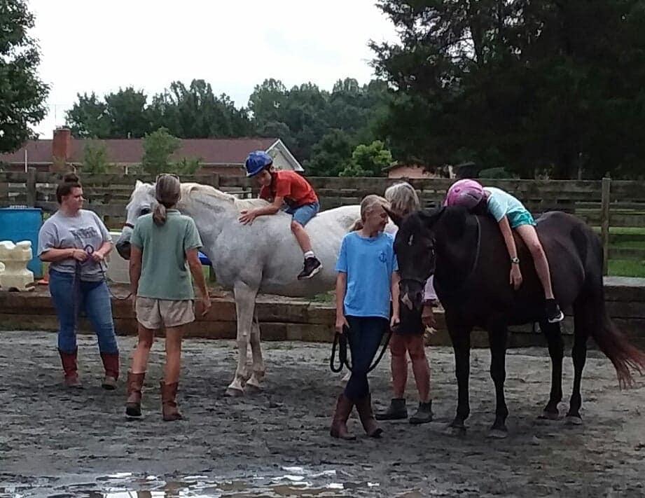 Happy Roots Children Riding Horses