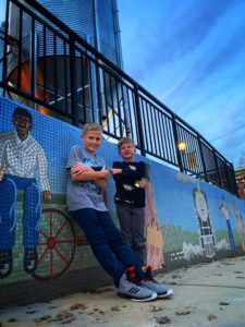 Bailey's children exploring local public murals.