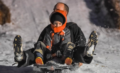 Sledding at Christmas in the Grove
