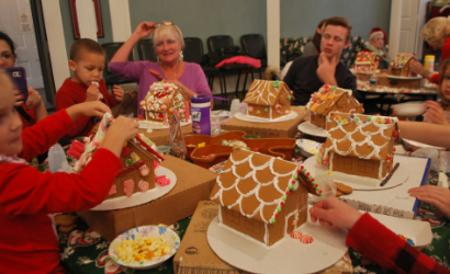 Families hard at work on the gingerbread house creations