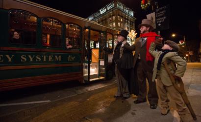 Ebenezer Scrooge guiding the Rowan community through his Christmas story.