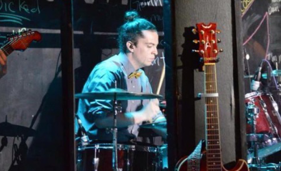 RJ Thornton jamming out on the drums